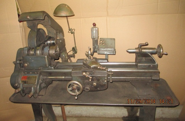 Arrow Pointing Down >> Logan 820 10x24 Lathe with extra tooling