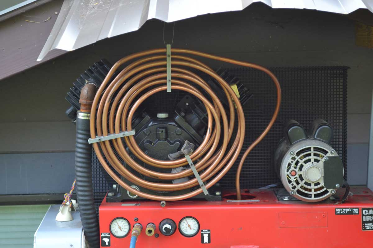 Air Compressor Cooler : How close can i put the check valve unloader to