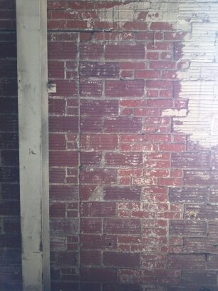 Ot Removing Paint From Interior Wall By Sand Blasting