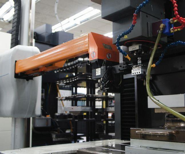 Omega's System 3R Workmaster carousel robot loads a pallet-mounted, pre-referenced electrode into a Mitsubishi EA-12V ram EDM unit. The workpiece on the table interfaces with the System 3R fixturing system via a custom sub-pallet.