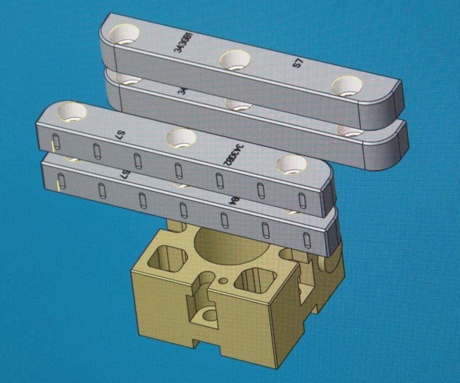 All parts are modeled in CAD/CAM software along with representations of the pallet, and all references are calculated according to the geometry of a custom tooling ball. In this case, Omega is making the most of its material by machining multiple gibs (components for mold slide assemblies) from the same block. The pallet shown here is a 54-mm model from System 3R.