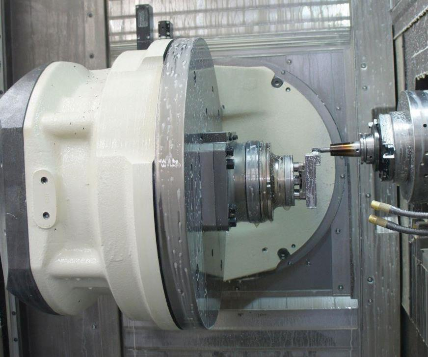 The Grob G350's horizontal, retractable spindle and single-sided, 180-degree trunnion ensure a spacious workzone. Its 202-position toolchanger is loaded with a standardized selection of cutters, all of which are guaranteed within 10 microns, mounted in shrink-fit holders and tied to material-specific parameter settings within the shop's CAM software tool library. Specifiying the table without T slots evidences Omega's commitment to eliminating process variation.